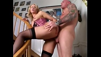 Guy plows smoking blonde in lingerie on the staircase