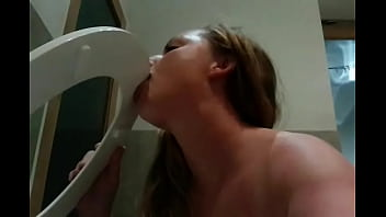 Busty big bbw licking the toilet seat clean after pissing in and on it
