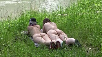 Voyeur outdoors peeps at two naked lesbians. Nudists with big asses sunbathe and enjoy nature and masturbation. 11分钟
