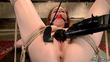 Redhead is sp toyed on hogtie bondage