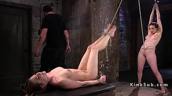 Two naked slaves in bondage whipped