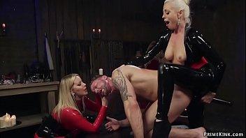 Femdoms In Latex Pegging Man Slave