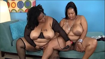 Two horny big booty MILFS fuck each other on the sofa with various toys