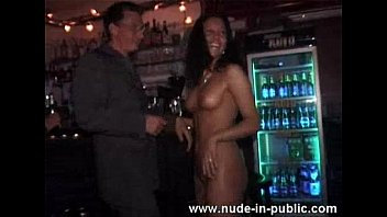 wild girl dancing nude at the bar preview image