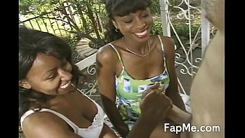 Two busty ebony girls wanking a cock