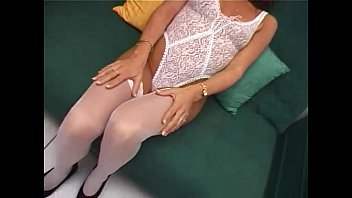 Young slut in white stockings gives a blow job!