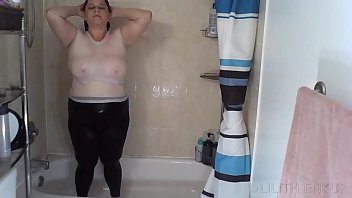 Shower In White Tank Top and Black Leggings