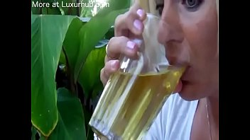 Milf drinks a glass of pee