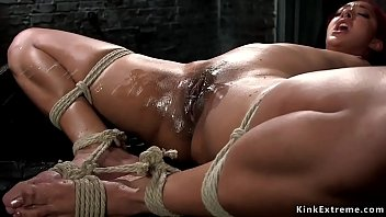 Redhead ebony in hogtie made squirting