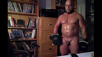 Muscle slave Doing Dumbbell Curls