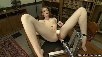 Pale redhead bangs machine in office