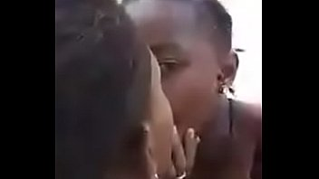 Two liberian lesbos making out in an uncompleted building