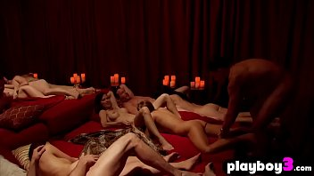 Shy ebony couple entered into red room with other swingers