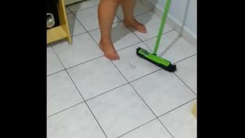 girlfriend tidying the room