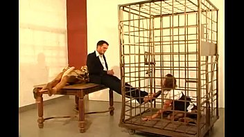 German secretary girl licks feet and sucks cock of her boss in cage