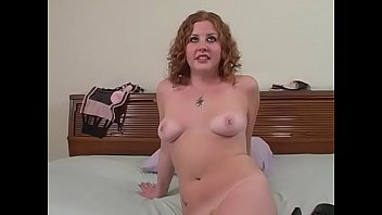 Playful redhaired hottie with strawberry patch Cherry Poppens enjoys caressing her twat with fingers