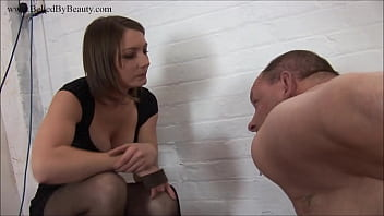 Mistress mercilessly punishes her slave on the floor.
