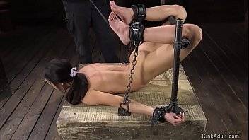 Ebony slave in device bondage whipped