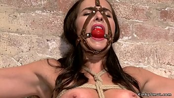 Gagged and tied brunette whipped naked