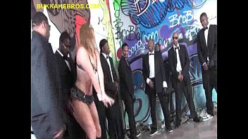 Blonde Takes Care a Bunch of Black Cocks