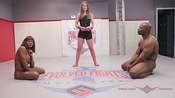 Muscular Ebony Babe Kelli Provocateur Meets her Match in Black Stud Will Tile During this Mixed Nude Wrestling Match صورة