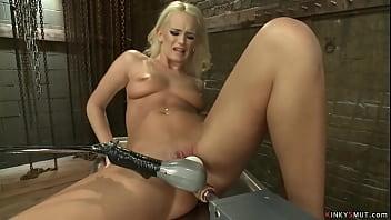 Blonde swings and fucks machine