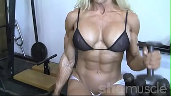 Man builds female sex toy Sexy blonde female bodybuilder in see through top works out