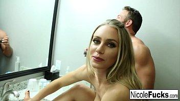 Hot Pornstar Nicole Aniston gives a foot job to a big cock