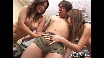 Two Japanese hotties chow down on a hard dong