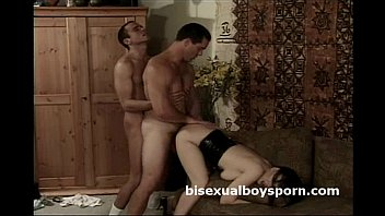 Two gay hunks in a bisexual train with a hot brunette