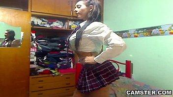 Big tits & ass Latin schoolgirl striptease out of her uniform