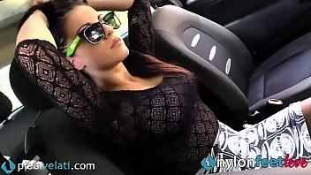 Hot brunette shows off her nylon feet right on the street