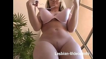Blonde girl changing her bra and jumping in topless