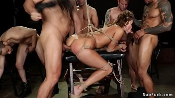 Sex addict is tied and group fucked