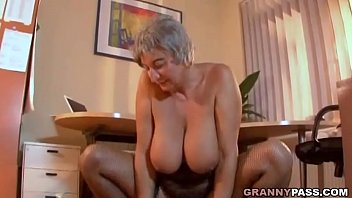 Busty Granny Seduces Young Guy With Her Big Tits porn image