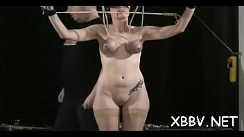 Bondage girl naked Naked wife stands tied up and endures heavy breast thraldom