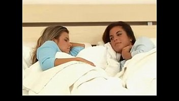 Lesbians play in bed