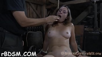 Bondage rack - Gagged babe gets her racks bounded and clamped