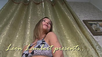Flashing in front of the window for Leon Lambert with some striptease and playing with a toy there 2 min