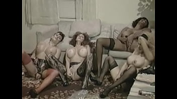 Horny bitches fucking with strapon in hot lesbian orgy