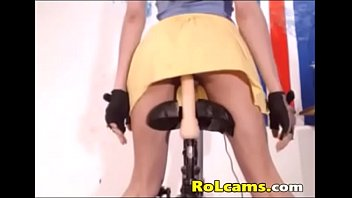 Teen riding dildo on bike