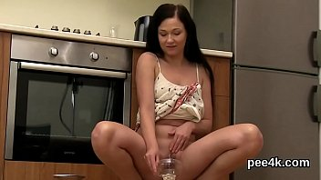 Perfect stunner gets her soft quim full of warm pee and splatters