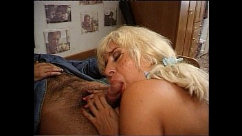 A blonde milf giving a blow job at home