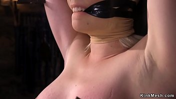 Blonde slave gets tits whipped to red