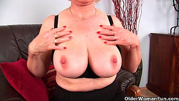 Granny Anna with her big tits finger fucks her sweet matured pussy