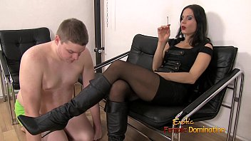 Domination smoking Female dominatrix using a slave like an ashtray