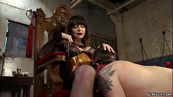 Busty dominatrix pegging tattooed man
