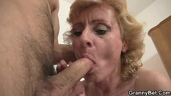 Blonde granny jumps on his cock thumbnail