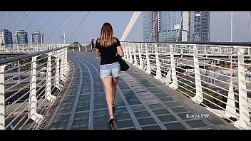 Katya takes a sexy high heels walking on the a bridge
