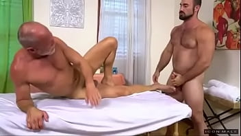 Old gay man puts on cock rings before having massage